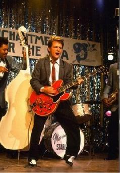 "Michael J. Fox playing ""Johnny B. Goode""  In Back to The Future ~ Click Here"