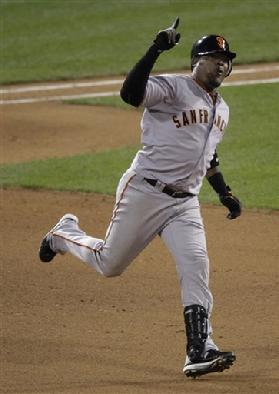 San Francisco Giants' Juan Uribe #5 reacts as he rounds the bases after hitting a home run during the eighth inning of Game 6 of baseball's National League Championship Series against the Philadelphia Phillies Saturday, Oct. 23, 2010, in Philadelphia...