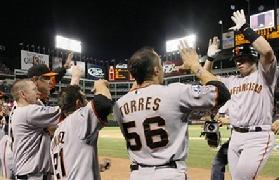 San Francisco Giants' Buster Posey, right, is congratulated after Posey hit a home run during the eighth inning of Game 4 of baseball's World Series against the Texas Rangers Sunday, Oct. 31, 2010, in Arlington, Texas. Click Here for more photos of game 4...