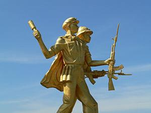 War memorial shows North Vietnamese and Pathet Lao soldiers attacking during the Vietnam War.