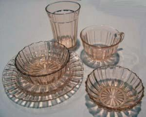 The pattern called Avocado (also known as Sweet Pear) was the first Depression Glass Pattern. It was made by Indiana Glass Company from 1923 to 1933.