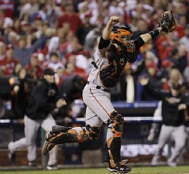 Catcher Buster Posey #28 reacts after the final out of the ninth inning of Game 6 of baseball's National League Championship Series against the Philadelphia Phillies Saturday, Oct. 23, 2010, in Philadelphia. The Giants won the game 3-2 to win the series and advance to the World Series...
