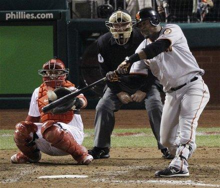 San Francisco Giants' Juan Uribe #5 hits a home run during the eighth inning of Game 6 of baseball's National League Championship Series against the Philadelphia Phillies Saturday, Oct. 23, 2010, in Philadelphia...