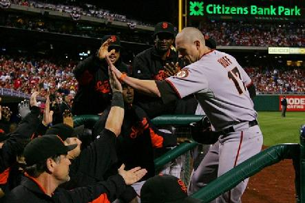 Aubrey Huff #17 of the San Francisco Giants celebrates after scoring in the third inning against the Philadelphia Phillies...