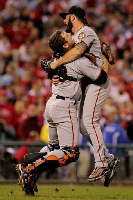 Buster Posey #28 and Brian Wilson #38 of the San Francisco Giants celebrate defeating the Philadelphia Phillies 3-2 and winning the pennant in Game Six of the NLCS during the 2010 MLB Playoffs...