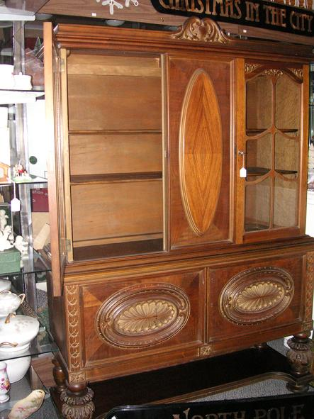 A circa 1920's walnut China Cabinet from H.E. Shaw Furniture Co. Manufacturers from Grand Rapids, Michigan.