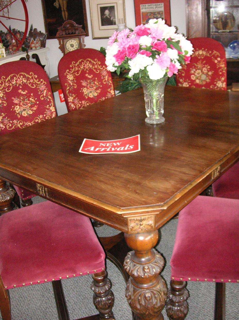 A circa 1920's walnut dining room table from H.E. Shaw Furniture Co. Manufacturers from Grand Rapids, Michigan.